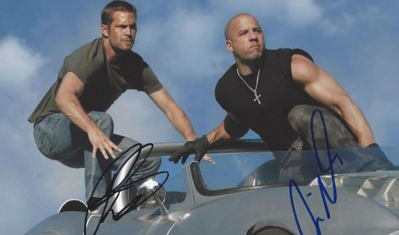 A picture from filming «The Fast and The Furious» autographed by Vin Diesel and Paul Walker