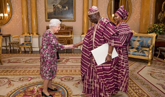 Queen Elizabeth at the reception with the Nigerian ambassador and his wife