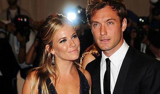 On the photo: Jude Law and Sienna Miller