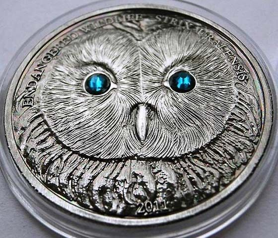 Coin with the image of the Ural owl