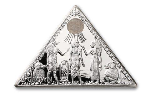 The silver pyramid coin has a triangular shape