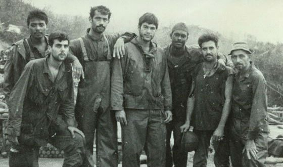 Oliver Stone (in the centre) and his platoon comrades