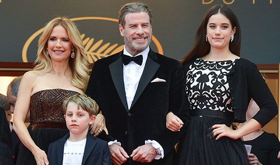 John Travolta, his wife, daughter and son