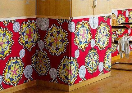 Можно оббить старый шкаф тканью - получится весело и задорно