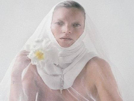 Kate Moss shot for a glossy magazine in the form of a nun.