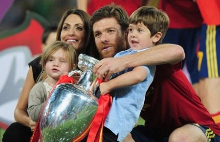 Xabi Alonso with his wife Nagore and two children