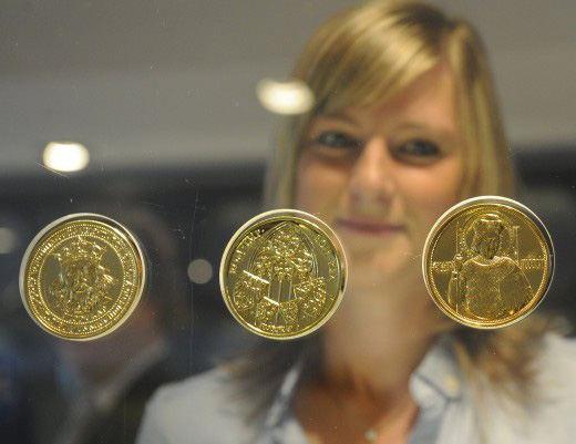 Олимпийские монеты из золотого сплава