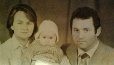 Ольга Гобозова с мужем и маленьким ребенком