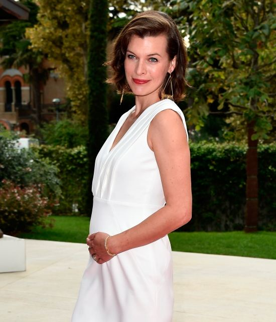 Jovovich at the Venice Festival showed a pregnant belly