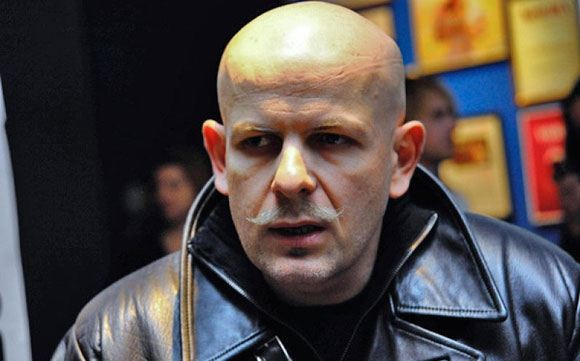 Ukrainian journalist Oles Buzin was shot dead in his apartment building