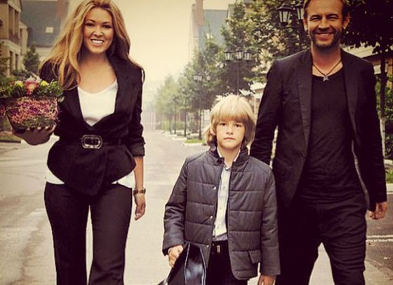 Irina escorts her son Artem to school