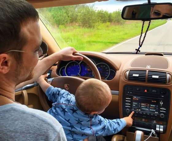 Fedor from an early age is already trying to control the machine with the help of his father.