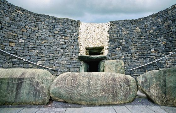 The stones at the entrance to the tomb are decorated with a spiral pattern.