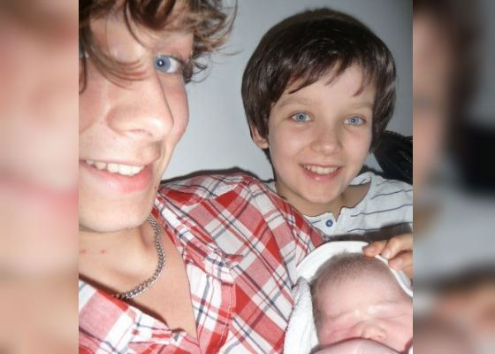 Asa Butterfield with elder brother and newborn sister