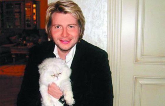 Золотой голос России с белым котом