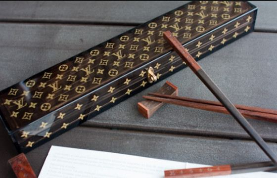 Louis Vuitton sticks will be in harmony with the bag of this brand.